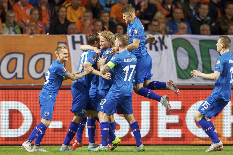 Mandatory Credit: Photo by Hoogte/REX Shutterstock (5036645a) (L-R) Ari Freyr Skulason of Iceland, Gylfi Por Sigurdsson of Iceland, Birkir Bjarnason of Iceland, Aron Einar Gunnarsson of Iceland, Johann Berg Gudmundsson of Iceland, Jon Dadi Bodvarsson of Iceland celebrate Netherlands v Iceland, UEFA Euro 2016 qualifier football match at Amsterdam Arena, The Netherlands - 03 Sep 2015