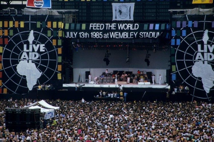 LONDON, UNITED KINGDOM - JULY 13:  A general view of the crowd and the stage during the Live Aid concert at Wembley Stadium in London, 13th July 1985. The concert raised funds for famine relief in Ethiopia.  (Photo by Georges De Keerle/Getty Images)