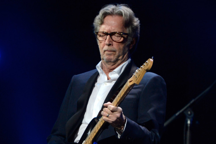 "NEW YORK, NY - DECEMBER 12:  Eric Clapton performs at ""12-12-12"" a concert benefiting The Robin Hood Relief Fund to aid the victims of Hurricane Sandy presented by Clear Channel Media & Entertainment, The Madison Square Garden Company and The Weinstein Company at Madison Square Garden on December 12, 2012 in New York City.  (Photo by Kevin Mazur/WireImage for Clear Channel)"